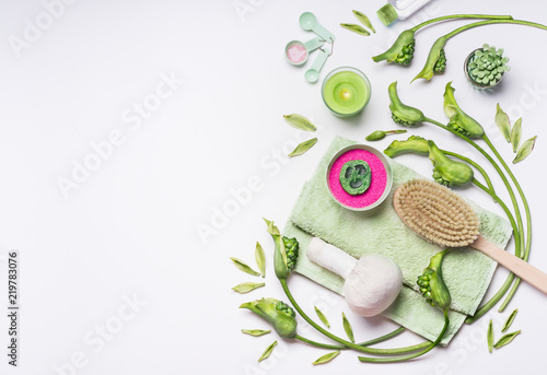 Garden Poster Spa Spa setting with green flowers and plants, massage tools, sea salt, towel and candle on white background, top view with copy space. Wellness concept , beauty treatment or cellulite remedies