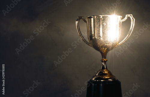 Canvas Print champion golden trophy placed on wooden table