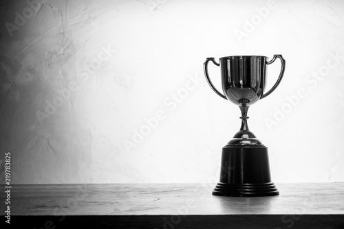 Tablou Canvas black and white champion golden trophy placed on wooden table
