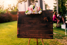 Blank Wooden Board With Flowers On Top Of It.