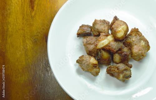 Fototapeta fried fermenting pork bone on white plate obraz
