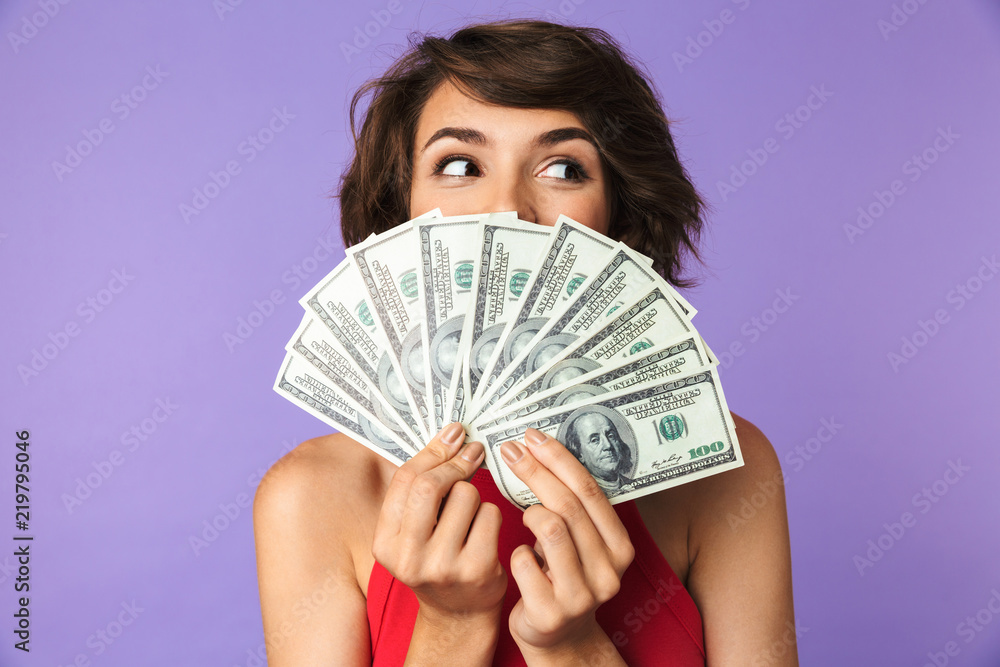Fototapety, obrazy: Happy Pretty brunette woman covering her face with money