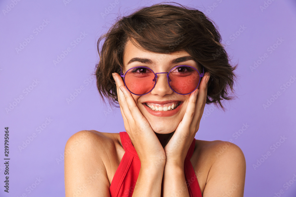 Fototapety, obrazy: Happy Pretty brunette woman in sunglasses touching her cheeks