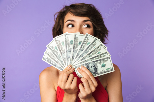Fotografía  Happy Pretty brunette woman covering her face with money