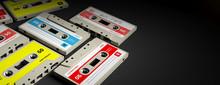 Vintage Audio Cassettes On Black Background, Banner, Copy Space. 3d Illustration