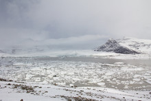 Wide View Of Fjallsárlón Glacier Lagoon Lake With Mountain In The Background
