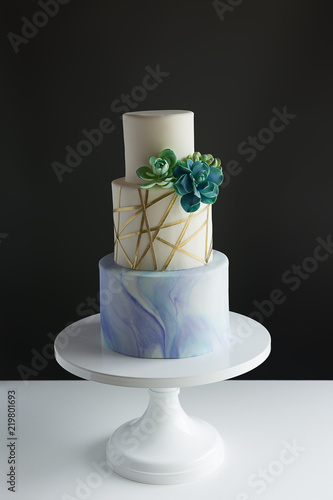 Fotografie, Obraz  3 tier modern wedding cake with marble, gold, geometric design, and edible succulent accents
