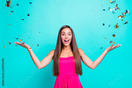 Obraz So perfect ideal day! Close up studio photo portrait of astonished wondered cheerful joyful cute lovely charming nice cool look staring eyes lady catching confetti isolated on bright shine background - fototapety do salonu