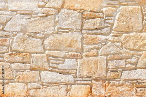 Fototapeta Wall of light, yellow Sandstone. Background image, texture.