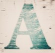 The letter A in grunge style on the old background