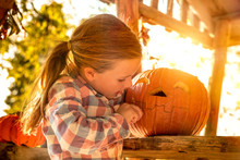 Little Girl Carving Halloween ...