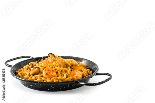 Traditional Spanish fideua. Noodle paella isolated on white background. Copyspace
