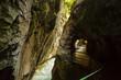 Walking trail through narrow, dark and deep Aare canyon