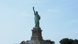 Panoramic lifestyle shot of iconic Statue of Liberty national monument in New York USA, view from a water tour boat.
