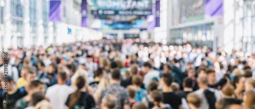 Valokuvatapetti defocused blurred people at a trade fair hall
