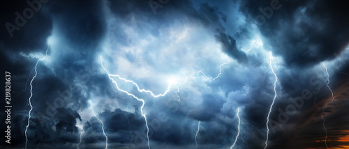 Obraz Lightning thunderstorm flash over the night sky. Concept on topic weather, cataclysms (hurricane, Typhoon, tornado, storm) - fototapety do salonu