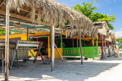 Thatch roof shops along the Seven Mile Beach in Negril, Jamaica Poster Mural XXL