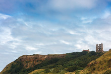 Dramatic Cliff Side Landscape With Scarborough Castle In North Yorkshire.