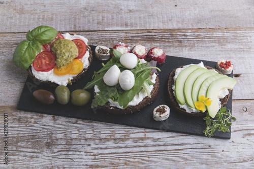In de dag Buffet, Bar canape with avocado, mozzarella ,tomato,pesto,olives, cream cheese. Mix of different snacks and appetizers
