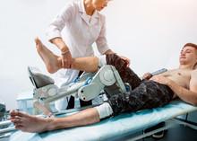 Patient On CPM (continuous Passive Range Of Motion) Machines.