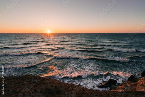 Fotografie, Obraz Sunrise over waves crashing the danish shore.