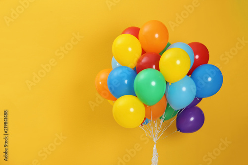 Fotografia, Obraz  Bunch of bright balloons and space for text against color background