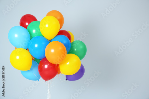 Cuadros en Lienzo Bunch of bright balloons and space for text against white background