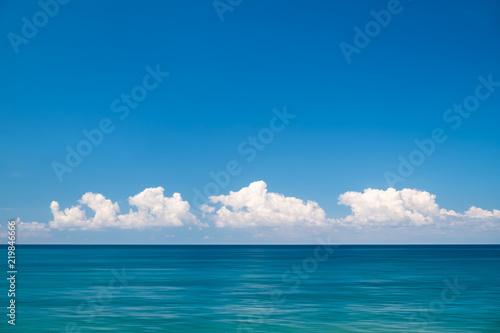 Staande foto Zee / Oceaan blue sea and cloudy sky over it