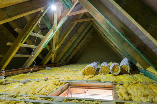 Fototapeta Empty attic in the house with mineral wool insulation