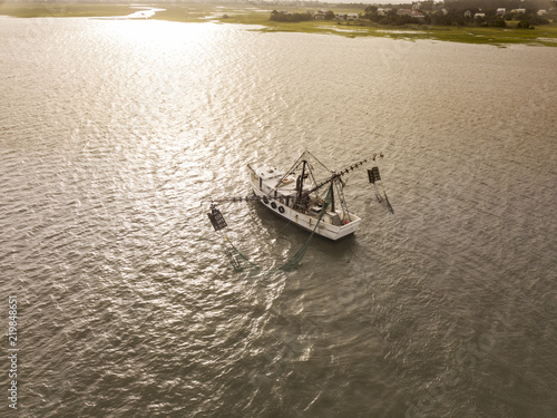 Aerial view of shrimp boat off the coast of South Carolina at sunrise,