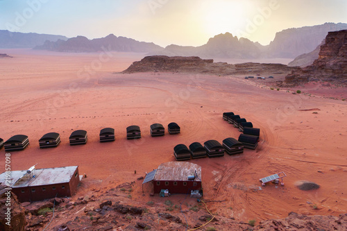 Photo  Camping tents near the rocks in Wadi Rum desert (The Valley of the Moon)