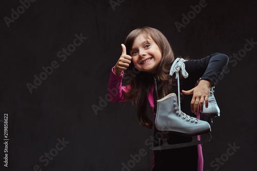 Joyful little girl dressed ...
