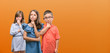 canvas print picture - Group of boy and girls kids over orange background serious face thinking about question, very confused idea