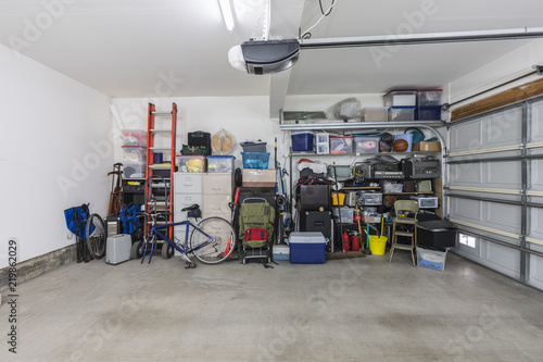 Cluttered but organized clean suburban residential two car garage with tools, file cabinets and sports equipment Wallpaper Mural