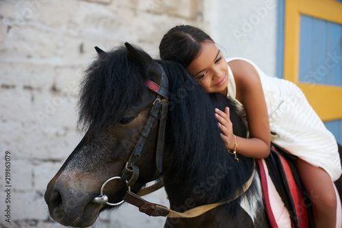 Fotografie, Obraz  Happy young girl on countryside with horse