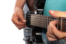 Man Playing Electric Guitar, Close-up On White Background