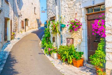 Fototapeta na wymiar A narrow street in the old town of Saint Paul de Vence, France