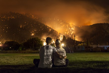 Young Couple Watches Forest Fire