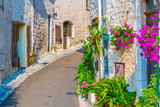 Fototapeta Uliczki - A narrow street in the old town of Saint Paul de Vence, France