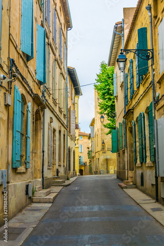 View of a narrow street in the historical center of Arles, France Wallpaper Mural