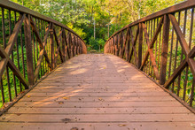 A Rustic Footbridge In The Aut...
