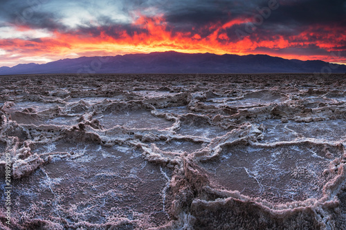 Fiery sunset over Badwater in Death Valley National Park