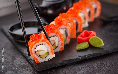 Staande foto Sushi bar sushi maki raw fish asian food japanese salmon seaweed rice