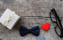 Glasses, Bow Tie And Red Heart On Rustic Wood Background, Father's Day Concept