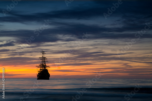 Canvas Prints Ship Old ship silhouette in sunset scenery, Italy
