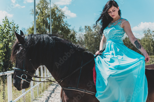 Fotografija  Romantic scene woman with a horse in the countryside