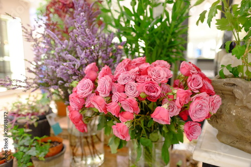 Romantic Flower bouquet arrangement with hot pink rose and purple Gypsophila