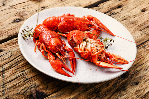 Staande foto Schaaldieren Crawfish on wooden background