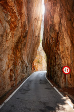 Narrow Road Cut Through A Moun...