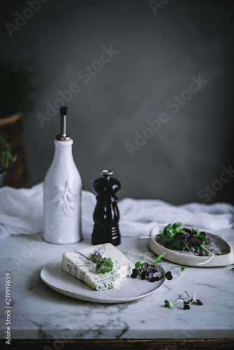 Blue cheese with herb on desk